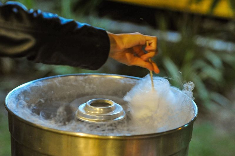 Cropped image of hand making cotton candy