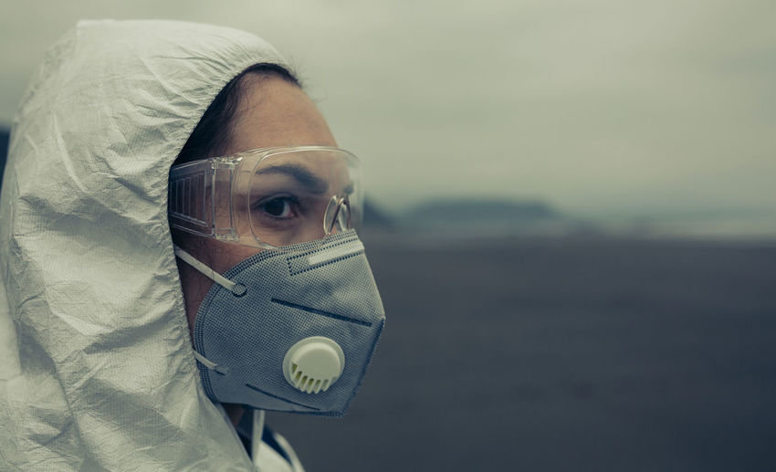 Close-up of woman wearing mask looking away