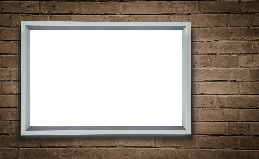 Empty frame against brick wall