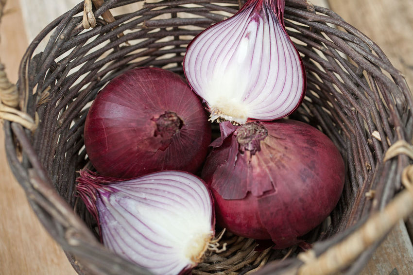 A basket with two whole and two half red onions Red Basket Close-up Food Food And Drink Freshness Half Harvest Healthy Eating High Angle View Indoors  Ingredient No People Nutrition Onion Purple Raw Food Spice Still Life Vegetable Wellbeing Wicker