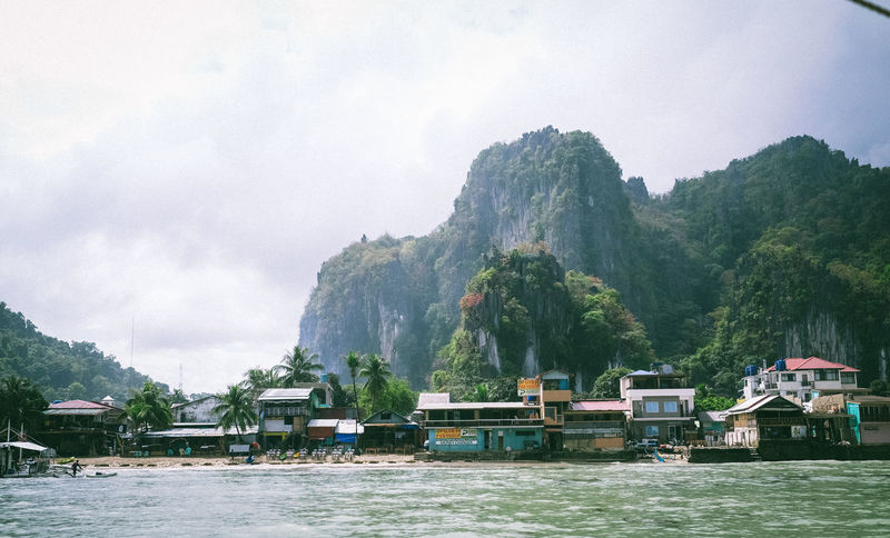 Beauty In Nature Built Structure Cloud Cloud - Sky Elnido Hoang Ann Mountain Mountain Range Nature River Sky Tranquility Traveling Wanderlust Water Waterfront
