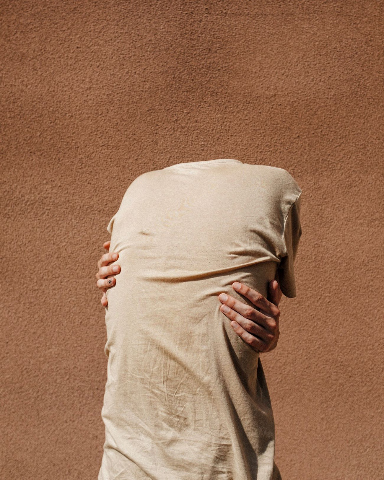 one person, obscured face, standing, adult, human body part