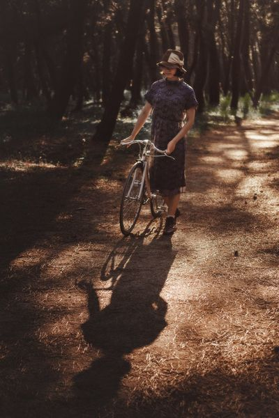 The Great Outdoors - 2017 EyeEm Awards The Portraitist - 2017 EyeEm Awards Real People Full Length Shadow Tree Bicycle Lifestyles Transportation Women EyeEm Best Shots Beautiful Woman Mid Adult EyeEmNewHere Portrait Forest Relaxation Growth Beauty In Nature