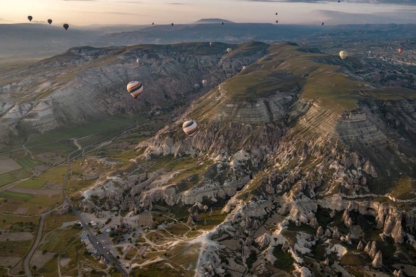 Nature Flying Landscape Nature Beauty In Nature Outdoors Mid-air Day Aerial View Scenics Adventure Mountain Sky Hot Air Balloon Travel Sunrise Journey Turkey Cappadocia Vacations Cappadocia/Turkey Travel Destinations Balloon