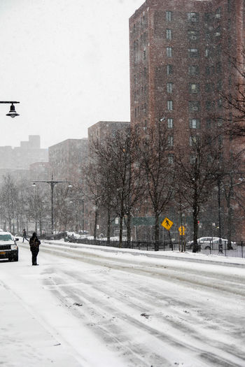 Let it Snow Vertical Architecture Bare Tree Bronx Building Exterior Built Structure City Cityscape Cold Temperature Comuting Day NY One Person Only Men Outdoors People Real People Sky Snow Snow ❄ Snowing Snowing ❄ Street Tree Winter Winter