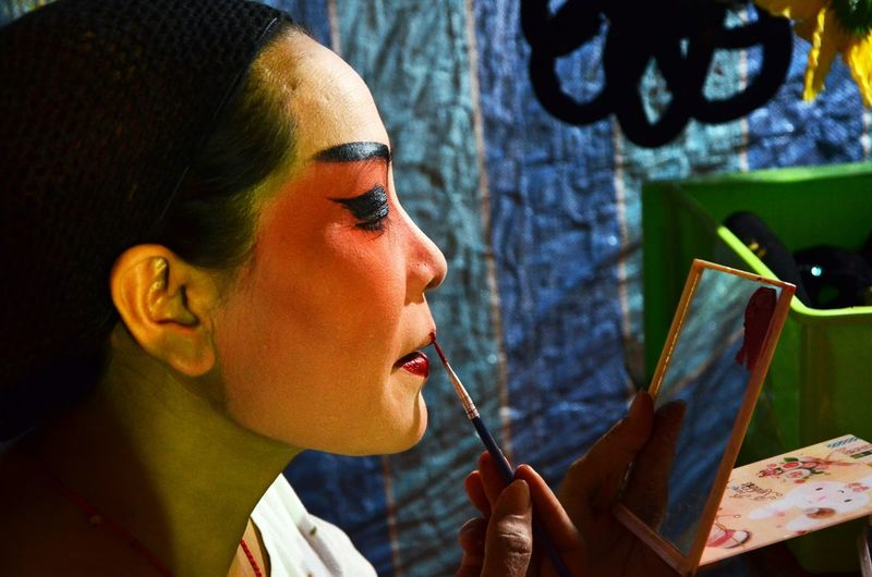 Chinese Opera Singer Backstage Chinese Opera Chinese Teochew Opera Mirror One Person Headshot Portrait Lifestyles Real People Glasses Women Adult Close-up Make-up Sunlight Focus On Foreground Communication Looking