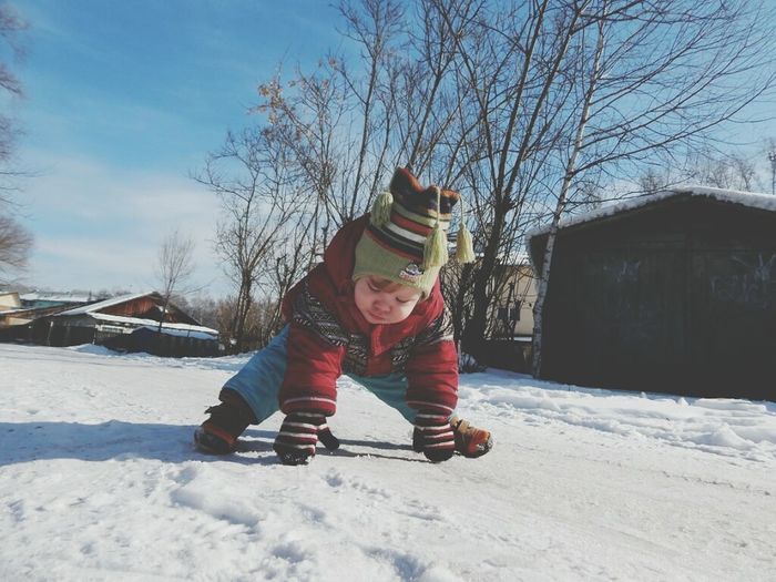 Winter Snow Cold Temperature Warm Clothing One Person Full Length Sky Outdoors Winter Sport Child Motion Bare Tree Childhood Playing Day People Snowing Tobogganing Ski Holiday Nature
