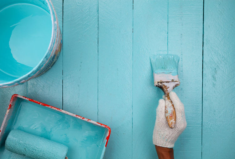 Close-up of clothes hanging on blue wall