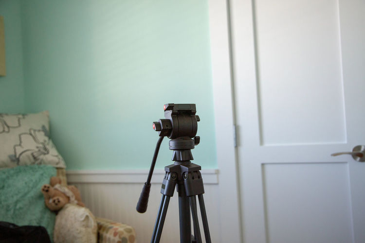 Tripod against wall at home