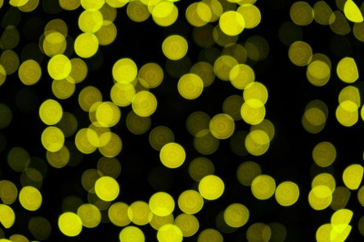 Colorful christmas abstract bokeh background. illumination light backdrop. festive street night