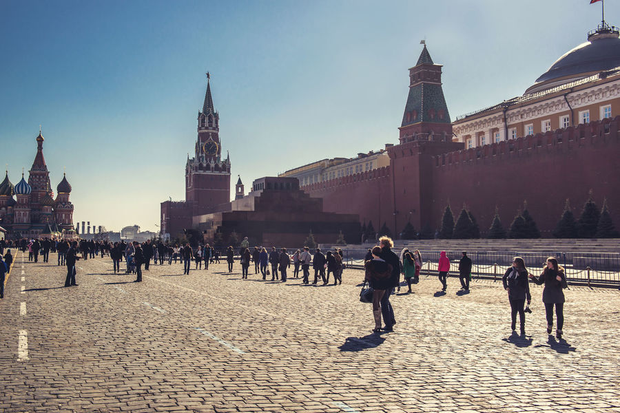 Moscow, Russia- March 10, 2014: View of Red Square on march 10, 2014 Kremlin Architecture Russia Moscow Red Square Moscow Russia Russian Culture Sightseeing Tourists Architecture Building Exterior Built Structure City Famous Place Full Length History Landmark Large Group Of People National Landmark Outdoors Real People Sky Tourism Travel Destinations Walking