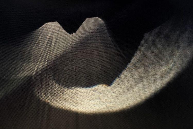 High angle view of shadow on wood