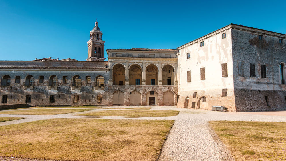 Panoramic view of Saint George Castle in Mantova Italy Ancient Architecture_collection Castle Churchporn Italy 🇮🇹 Panorama Sankt Georg Ancient Architecture Architecture Blue Blue Sky Building Exterior Built Structure Clear Sky Day Gonzaga Lombardia Mantova, No People Outdoors Sky