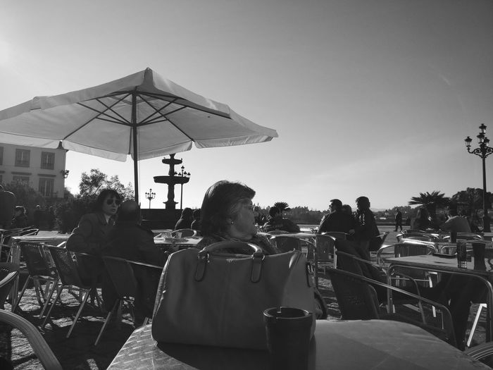 People at restaurant against clear sky