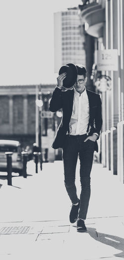 Man dressed smart with hat and glasses in city. Adult Adults Only Black & White Black And White Blackandwhite Blazer Braces Business City City Life Fashion Fashion Photography Glasses Hat Jacket One Person People Shirt Smart Stylish Suit Walking Watch Young Adult