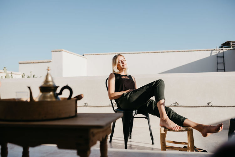 Architecture Chilling Enjoying The Sun Freedom Minimalist Architecture Morocco Relaxing Roof Rooftop Tea Terrace Travel Trip Woman Enjoying Life House Interior Design Marrakech Minimalism Relax Riad Succulent Plant Travel Destinations Woman Portrait Women