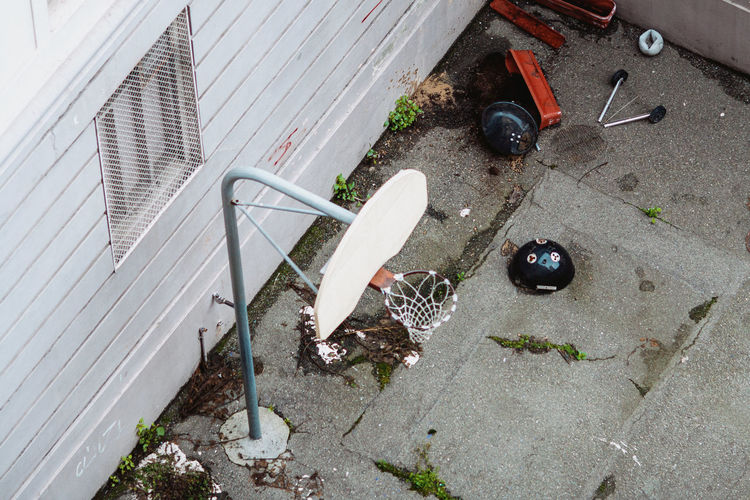 High angle view of broken glass on footpath in city