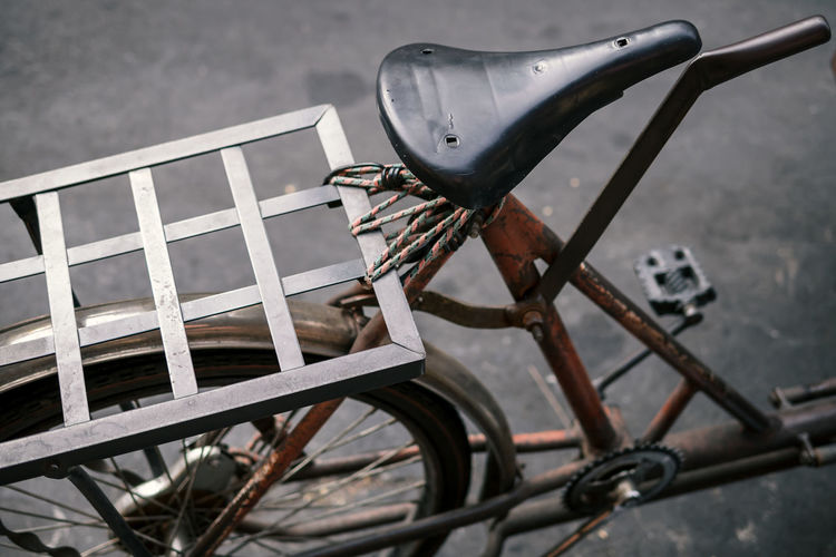 Detail of classic vintage saddle of saleng or tricycle or three-wheel bicycle