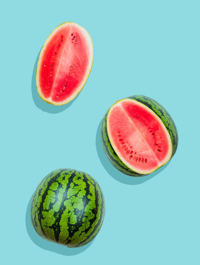 Pieces of watermelon on plain blue background Food Fruit Ripe No People SLICE Watermelon Freshness Wellbeing Healthy Eating Diet Clean Freshness Fresh Fruity Sweet Summer Organic Natural Ingredient Green Melon Lay Flat Vegetarian