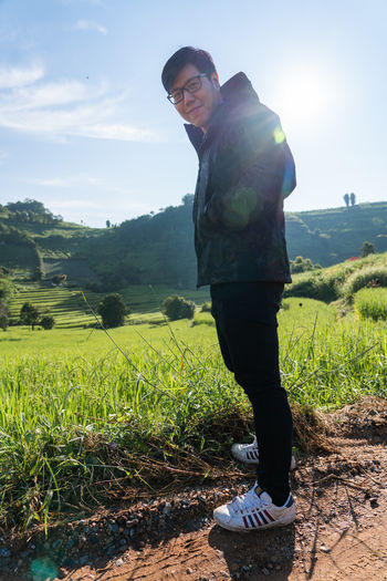 Travel ASIA Asian  Thailand Thai One Person Plant Green Color Real People Sunlight Sky Land Full Length Field Landscape Leisure Activity Nature Grass Casual Clothing Day Standing Young Men Beauty In Nature Lifestyles Scenics - Nature Outdoors