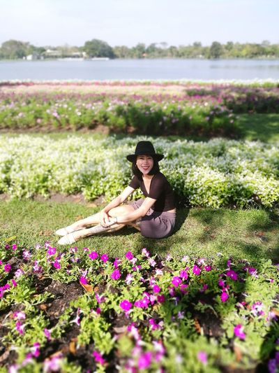 Only Women One Woman Only Adult Nature Flower Adults Only One Person Summer Outdoors People Young Adult Beauty Beautiful Woman Women Rural Scene Young Women Relaxation Day Sitting Field