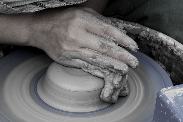 Cropped Image Of Potter Working At Workshop