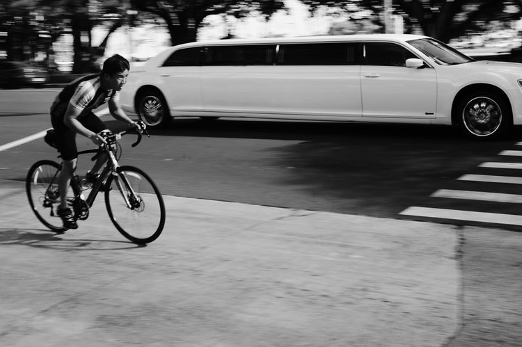 Black And White Friday Transportation Bicycle Mode Of Transport Land Vehicle Car Real People Full Length Outdoors One Person Men Day Motion People