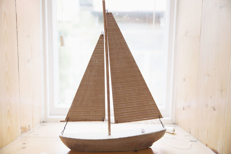 Wooden Boat On Window Sill At Home