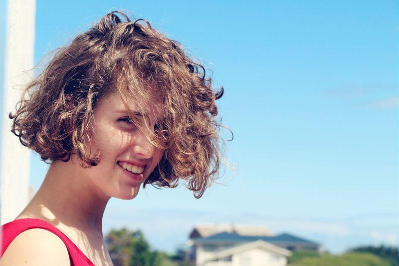 Portrait Of Smiling Woman Against Sky
