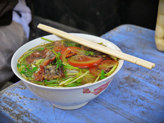 High angle view of noodle soup served in bowl at table