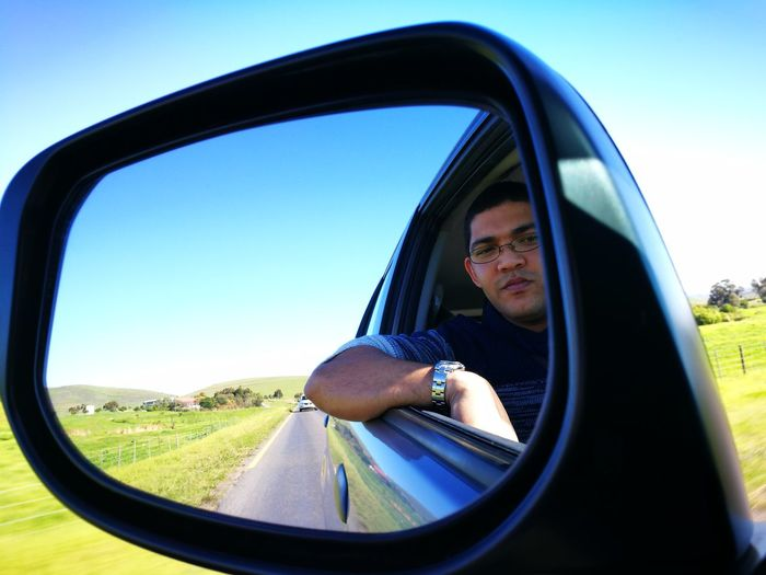 View Of Man In Side-View Mirror