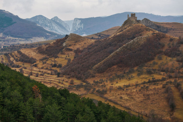 Landscapes from Transylvania, Romania. Autumn Cloudy Hills Nature Pine Ruins Trees Beauty In Nature Brown Forest Landscape Mountain Mountain Range No People Old Outdoors Ruin Scenery Scenics Sky Stronghold Viewpoint