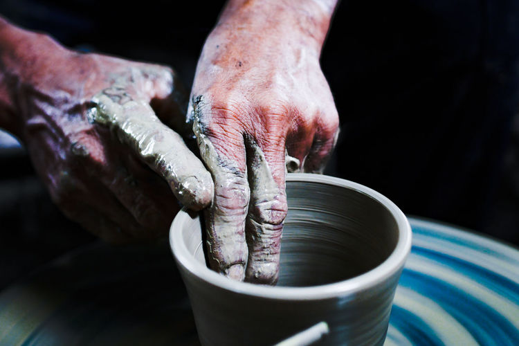 Close-up of artist making pot at workshop