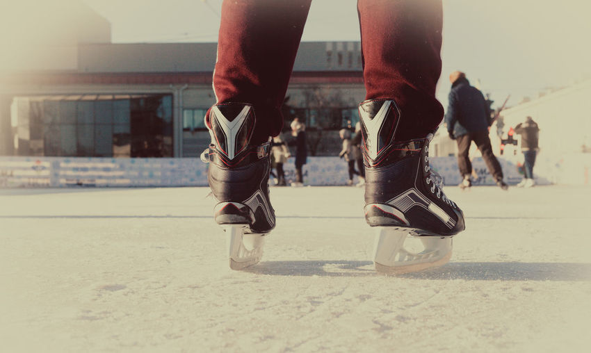 Low section of person ice skating