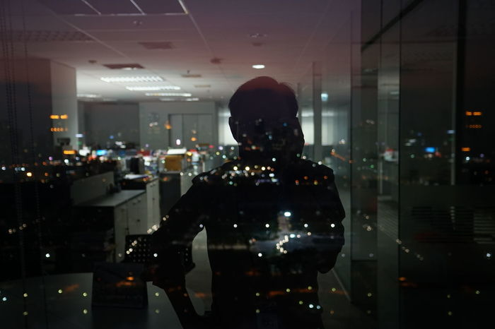 HUAWEI Photo Award: After Dark City Cityscape Glass - Material Illuminated light and reflection Light And Shadow Night Office At Night Office Building One Person Reflection Scattered Light Self Portrait Standing Transparent Window