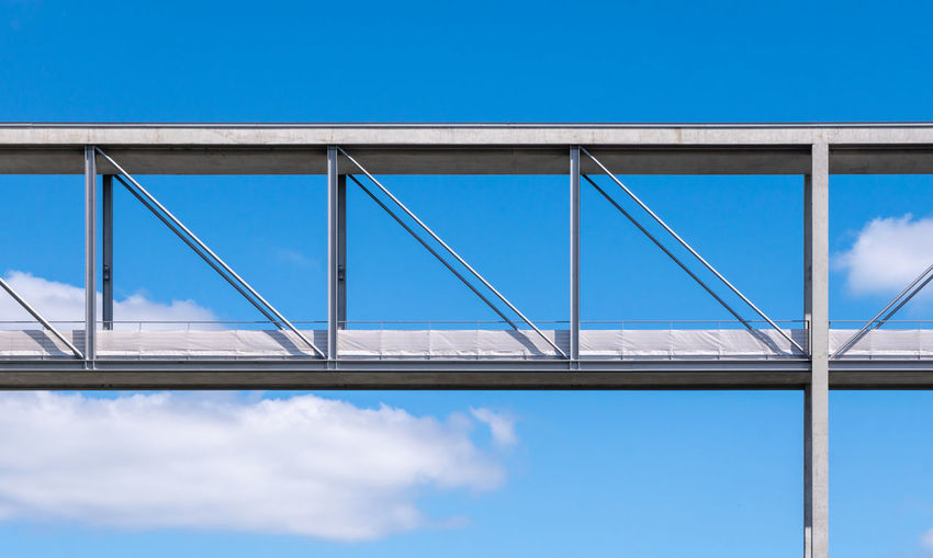 Low angle view of bridge against sky during sunny day