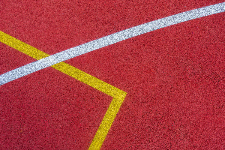 Colorful sports court background. top view to red and blue field rubber ground with  lines outdoors