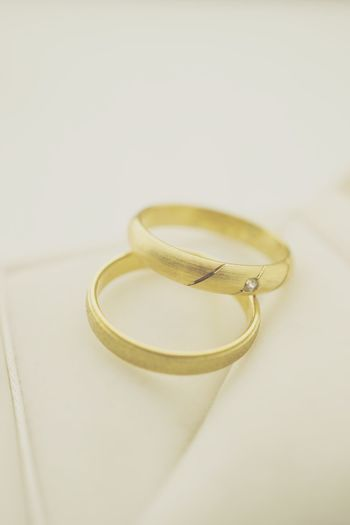Matte wedding rings with copy space Wedding Card Wedding Wedding Invitation Hochzeit Hochzeitseinladung Wedding Rings Nobody Jewellery Matte Beige Jewelry Ring Wedding Ring Love Still Life Wedding Indoors  Gold Colored Celebration Two Objects Gold No People Personal Accessory Close-up Life Events
