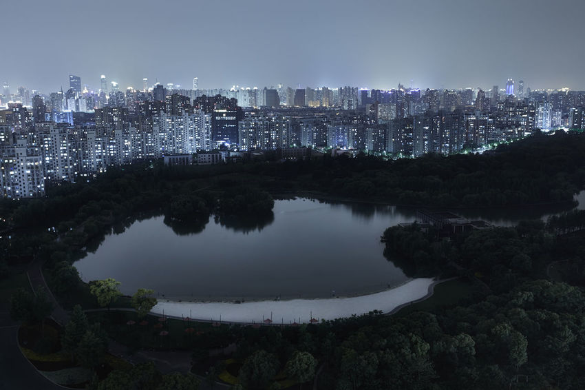 Night view of Shanghai overlooking the lake at the Daning Lingshi Park Architecture ASIA Built Structure China City City Life Cityscape Darkness Glowing Glowing In The Dark Growth Illuminated Lake Lightpolution Night No People Rooftop View  Shanghai Sky Skyline Surreal Tranquility Water Fine China