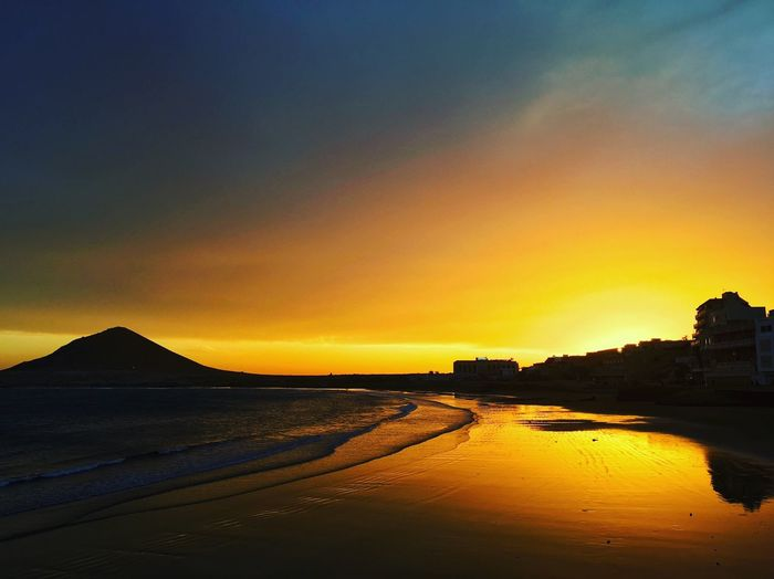 Atardecer sureño isleño Landscape Sky Sunset Water Scenics - Nature Orange Color Beauty In Nature Tranquility Tranquil Scene Nature Sea No People Beach Outdoors Mountain Silhouette Land Reflection