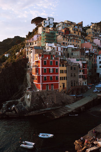 Riomaggiore at sunset. The time when the tourist masses are gone and it's becoming more quiet in Cinque Terre. Cinque Terre Harbor Italy 🇮🇹 Liguria,Italy Mediterranean  Travel Architecture Building Cinque Terre Liguria City Colorful Europe Harbor View Italy Italy❤️ Italy🇮🇹 Liguria Riomaggiore Sea Sky Sunset Tourism Town Vacation Village