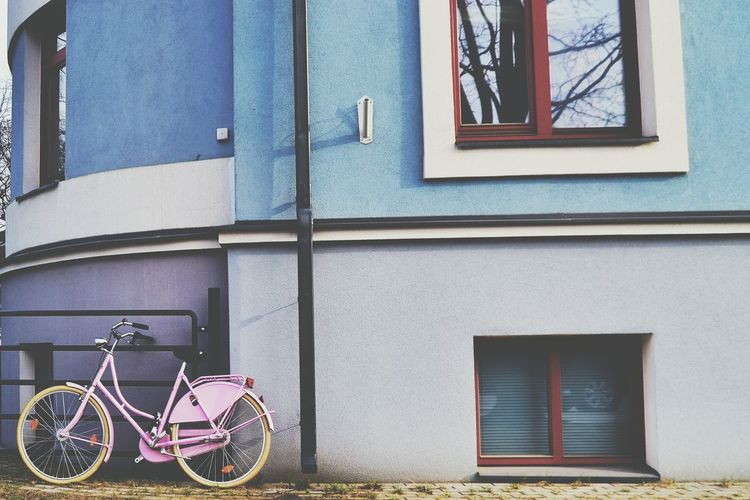 Bicycle by window of building