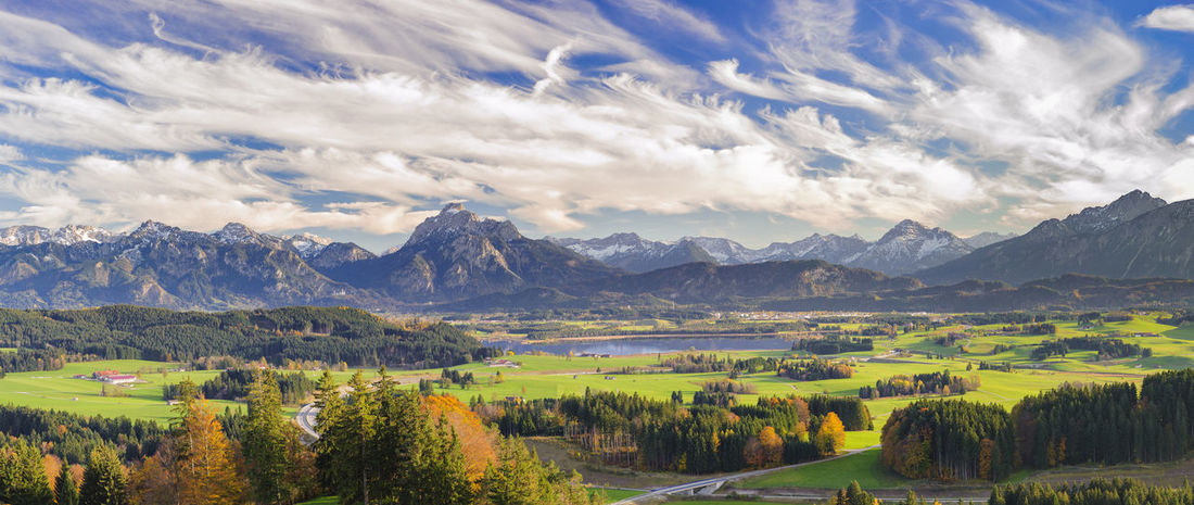 panorama scene in region Allgäu at lake Forggensee with beautiful clouds on sky Allgäu Autumn Leaves Bavaria Fall Colors Panorama Panoramic Rural Scenic Alps Beauty In Nature Cloud - Sky Clouds And Sky Forggensee Germany Lake Landscape Mountain Mountain Range Panoramic Landscape Rural Landscape Rural Scene Scene Scenery Scenic View Wide Angle