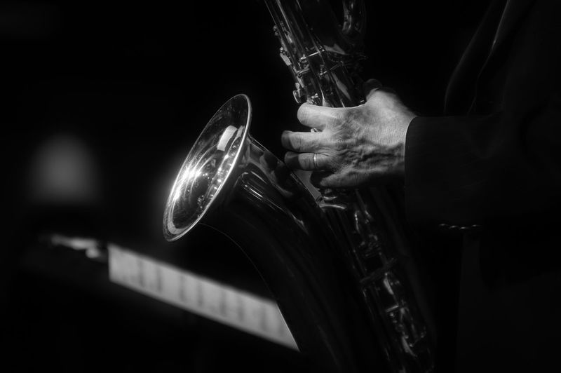 Midsection Of Musician Playing Saxophone