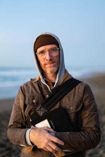 Portrait of man standing against sea