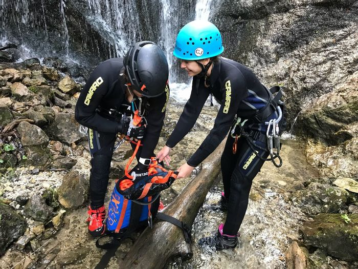 Canyoning Helmet Full Length Day Nature Leisure Activity Sport Protection Headwear Child Childhood Real People Males  People Two People Sunlight Security Sports Equipment Sports Helmet Outdoors