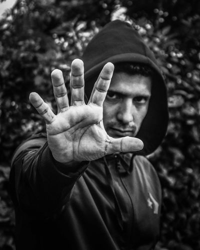 Close-Up Portrait Of Man Gesturing Stop