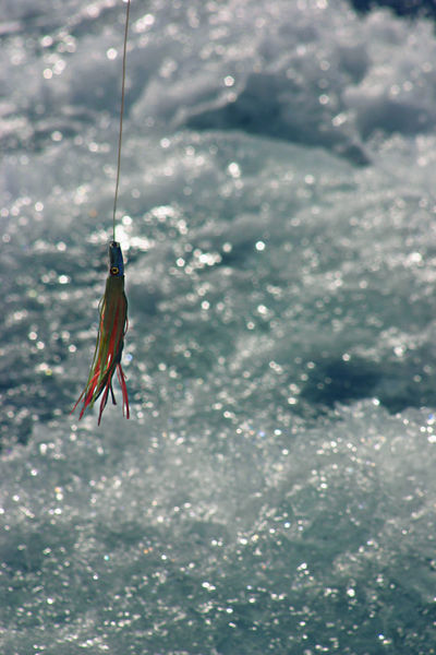 Blue Ocean Close-up Fishing Fishing Lure Focus On Foreground Open Ocean Outdoors Rough Water Sea Water