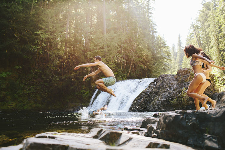 People jumping in forest