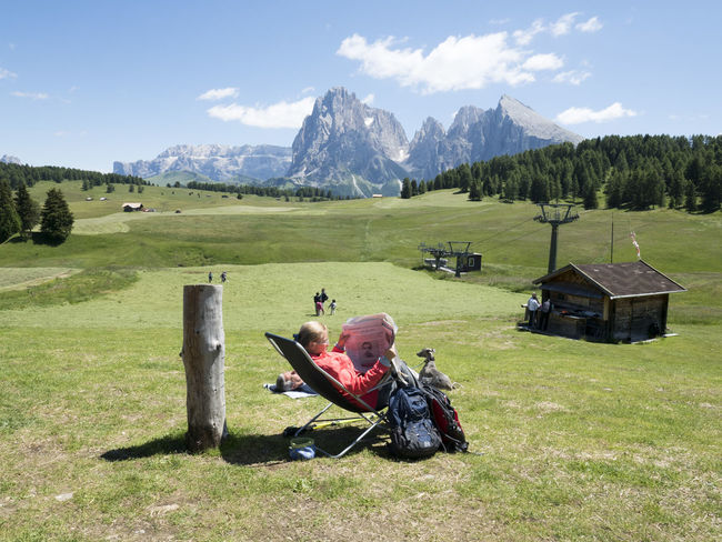Grass One Person Landscape Adult Mountain Outdoors One Woman Only People Adults Only Golf Beauty In Nature Golf Course Sky Nature Day Golf Club Sellaronda Mountain Range Tourism Mountain Peak Sella_gruppe Dolomites, Italy Beauty In Nature
